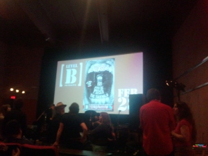 A view inside of the theater with the ad for the show